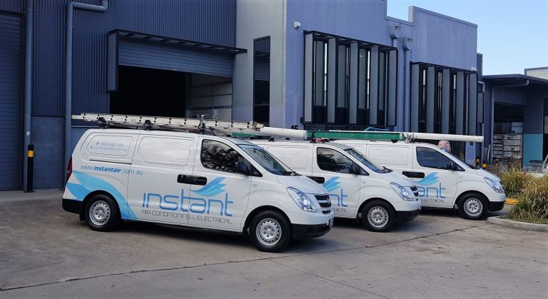 Instant Air Conditioning background image of company vans with branded signage